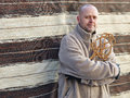 Man and carpet beater homeworks a the Stock Photography