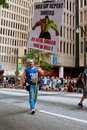 Man carries sign urging sinners to repent at atlanta parade ga usa august a carrying a showing the incredible hulk urges Royalty Free Stock Images