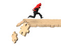 Man carrying arrow up symbol running on breaking puzzle path Royalty Free Stock Photo