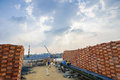 Man carrying a basket of rice husk brick kiln factory cloud sky with rays mekong delta vietnam Royalty Free Stock Image