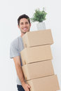 Man carrying boxes because he is moving handsome Royalty Free Stock Photos