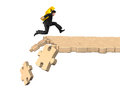 Man carrying dollar sign running on breaking puzzle path Royalty Free Stock Photo