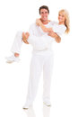 Man carrying girlfriend happy men in his arms on white background Stock Photo