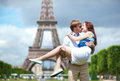 Man carrying girlfriend in his arms in Paris Stock Photo