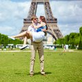 Man carrying his girlfriend in his arms paris Stock Photo