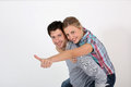 Man carrying his girlfriend on his back young men Royalty Free Stock Image