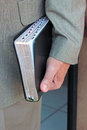 Man carrying holy bible the hand of a standing holding a thumb indexed Royalty Free Stock Image