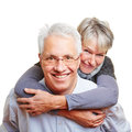 Man carrying senior woman piggyback Royalty Free Stock Photos