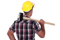 Man carrying sledge hammer over shoulder Stock Photo