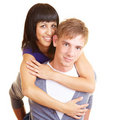 Man carrying woman Stock Photos