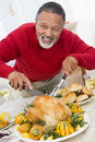 Man Carving Roast Chicken Stock Image