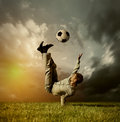 Man in casual suit playing in football Royalty Free Stock Photo
