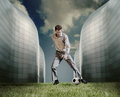 Man in casual suit playing in football near the modern building Royalty Free Stock Photo