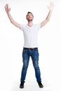 Man with in casuals with raised hands up isolated young happy on white Royalty Free Stock Photo