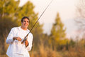 Man catching fish happy young a with rod by the lake Stock Photos