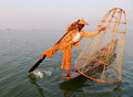 A man catching fish on the lake in Inle, Myanmar Royalty Free Stock Photo