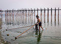 A man catching fish on lake in Mandalay, Myanmar Royalty Free Stock Photo
