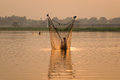 A man catching fish by net in Mandalay, Myanmar Royalty Free Stock Photo