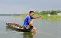 A man catching fish on river in Mekong Delta, Vietnam Royalty Free Stock Photo