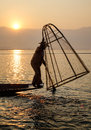 A man catching fish at sunrise in Shan, Myanmar Royalty Free Stock Photo