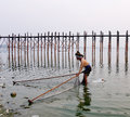 A man catching fish on Taungthaman Lake in Myanmar Royalty Free Stock Photo