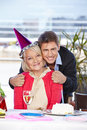 Man celebrating birthday with his happy adult men senior mother Royalty Free Stock Photos