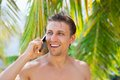 Man cell phone call smile on beach summer vacation Royalty Free Stock Photo