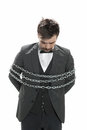 Man in chains attractive young business suit looks sullen as he stands with around him isolated on white Stock Image
