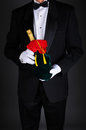 Man With Champagne Bottle in Gift Bag Royalty Free Stock Photos
