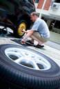 Man changing his car tyre Stock Photo