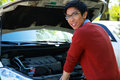 Man checking his car engine young happy asian Stock Photos