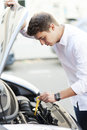 Man checking oil level in car young Stock Image