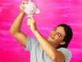 Man checking piggy bank Stock Photo