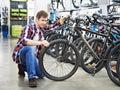 Man Checks Bike Before Buying ...