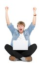 Man cheering with laptop computer Royalty Free Stock Images