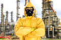 Man in chemical protective suit over factory Royalty Free Stock Images