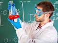 Man chemistry student with flask. Stock Photos