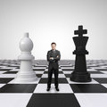Man on chessboard young businessman standing with chess Royalty Free Stock Photo