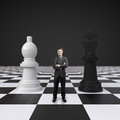 Man on chessboard young standing with chess Stock Images