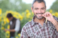 Man chewing on corn in a field Stock Photography