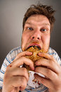 Man chewing hamburger Stock Photography