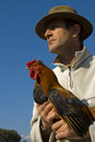 Man and chicken Royalty Free Stock Photography