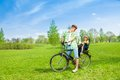 Man with child on the bike young men riding a little boy in seat Stock Photography