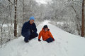 Man and child on snow after storm a a the a Royalty Free Stock Photo