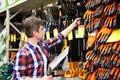 Man chooses shovel in shop Royalty Free Stock Photo