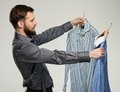Man choosing shirts handsome with beard shirt Royalty Free Stock Photos