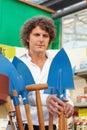 Man choosing shovel Royalty Free Stock Photo