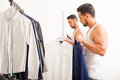 Man choosing between two shirts Royalty Free Stock Photo