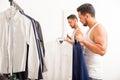 Man choosing between two shirts Royalty Free Stock Photo