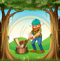 A man chopping the woods near the trees illustration of Royalty Free Stock Image